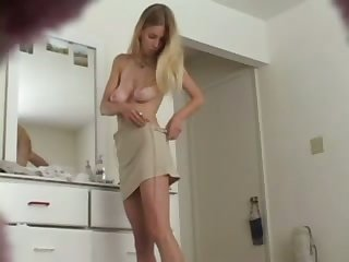 Hot blonde is trying on sexy outfits and she has no idea she's being filmed