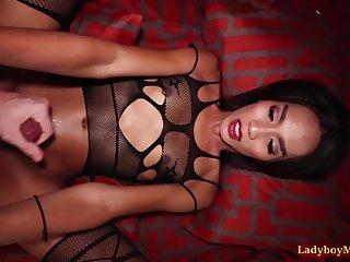 Thai ladyboy Game in her kinky fishnet paraphernalia enters the bedroom