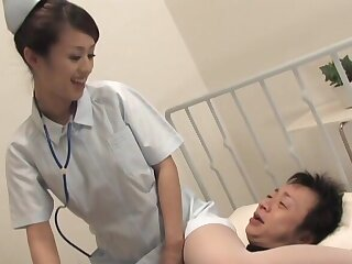 Kinky Asian nurse Ami Matsuda spreads their way hands to ride a patient
