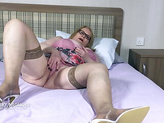 Sally's huge tits in and out of a flowery negligee