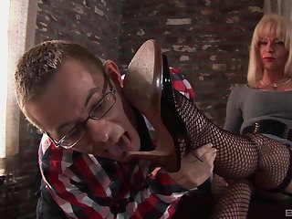 Mature shemale plays dominant with younger male slave