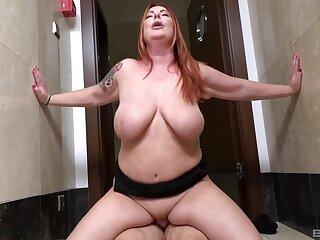 Busty mature wife Martina enjoys riding her younger neighbor's dick