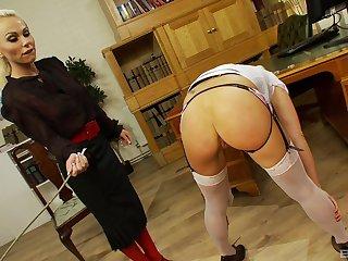 BDSM fetish lesbian session with Caprice Jane spanking Anna Lovato