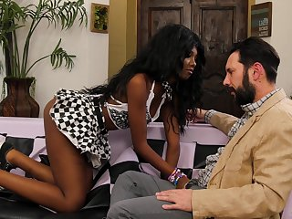 Gorgeous black babe Daizy Cooper swallows cum from a white dick