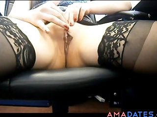 Naughty milf fingering her pussy at the office