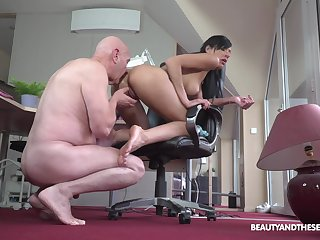 Senior man gets his hands not susceptible a young pussy