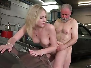 Awesome sexy blonde chick rides older man's strong cock yon the garage