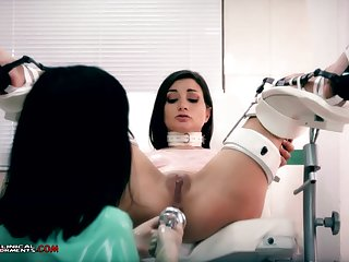 Stupid nurse, Minerva is toying with Valentina Bianco, while they are alone in the office