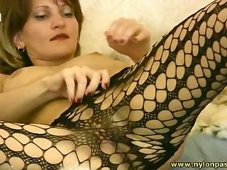 Lustful slut is playing with herself in the hottest pantyhose solo action