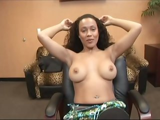 Slutty ebony lady fro long, curly hair had sex in her office, during a lunch side with